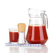 Tomato juice in pitcher and glass isolated on white — Stock Photo