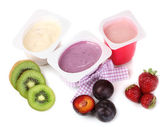 Fruit yogurts isolated on white — Stock Photo