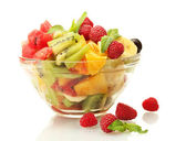 Fresh fruits salad in bowl and berries, isolated on white — Stock Photo
