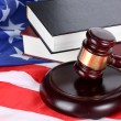 Royalty-Free Stock Photo: Judge gavel and books on american flag background