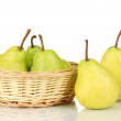 Ripe pears in wicker basket isolated on white — Stock Photo #12271465