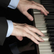 Man hands playing piano — Stock Photo