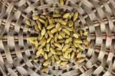 Green cardamom on wicker mat close-up — Stock Photo