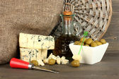Composition of blue cheese and olives in a bowl on wooden background close-up — Stock Photo