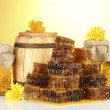 Stock Photo: Sweet honeycombs, barrel and jars with honey, isolated on white