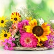 Beautiful bouquet of bright flowers on nature background — Stock Photo