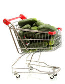 Fresh cucumbers in trolley isolated on white — Stock Photo