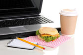 Eating at work place near laptop — Stock Photo