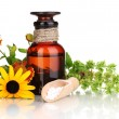 Medicine bottle with tablets and flowers isolated on white — Stock Photo #12322562