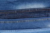 Muchos pantalones vaqueros closeup — Foto de Stock