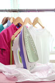 Electric iron and shirt, on cloth background — Foto de Stock