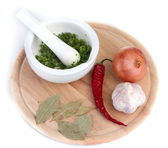 Composition of White mortar and pestle with vegetables and spice on cutting board isolated on white — Stock Photo