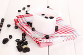 Yogurt with berries on wooden background — Stock Photo