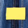 Many jeans with label closeup — Stock Photo #12363572
