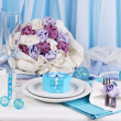 Serving fabulous wedding table in blue color on blue and white fabric background - Stock Photo