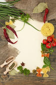 Paper for recipes vegetables, and spices on wooden table — Stock Photo