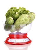 Fresh green vegetables in scales isolated on white — Stock Photo