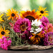 Beautiful bouquet of bright flowers on  wooden table on nature background — Stock Photo