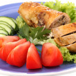 Постер, плакат: Tasty meat cutlet with garnish on plate close up