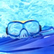 Blue flippers and mask on blue sea background - Foto de Stock