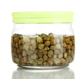 Glass jar with capers isolated on white — Stock Photo