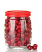 Fresh cornel berries in glass jar isolated on white — Stock Photo
