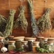 Dried herbs, spices and and pepper, on wooden background — Stock Photo #12401413