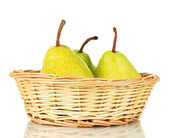 Ripe pears in wicker basket isolated on white — Stock Photo