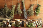 Dried herbs, spices and and pepper, on wooden background — Foto Stock