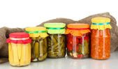 Jars with canned vegetables on canvas background — Stock Photo