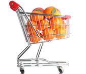 Ripe tasty tangerines in shopping cart isolated on white — Stockfoto