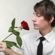 Portrait young man and rose enamoured love — Stock Photo