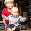 Stock Photo: Little boy playing with a brother