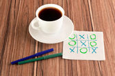 Tick-tack-toe on a napkin — Stock Photo