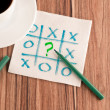 Tick-tack-toe and question mark on a napkin — Stock Photo