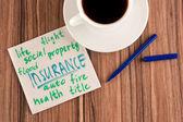 Insurance on a napkin — Stock Photo
