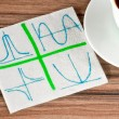 Graphics on a napkin — Stock Photo