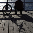 Man, bicycle at the pier — ストック写真