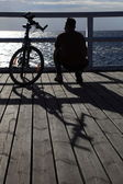 Man, bicycle at the pier — Stock Photo