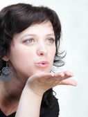 Woman blowing a kiss woman isolated — Stock Photo
