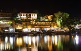 Coastal city illuminated at night in summer — Stock Photo