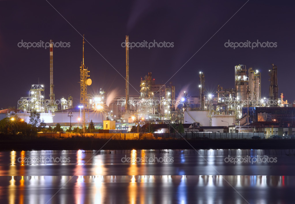 Night scene of petrochemical plant with water reflection  Stock Photo #11025342