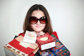 A girl in glasses after shopping — Stock Photo
