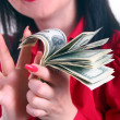 A girl counts the money isolated — 图库照片