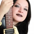 Pretty girl posing with a guitar isolated — Stock Photo #11040748