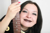 Girl smiling with guitar isolated — Stock Photo