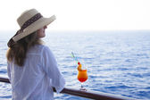 Girl on the deck drinking a cocktail — Stock Photo