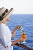 Girl on the deck enjoying cocktails — Stock Photo