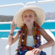Blond girl on a yacht in the Hat - Stok fotoğraf