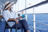 A woman in a hat and a cocktail on the liner — Stock Photo
